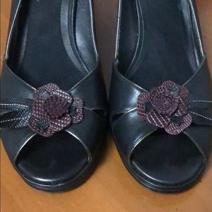 Black heels with cut out detail flowers.